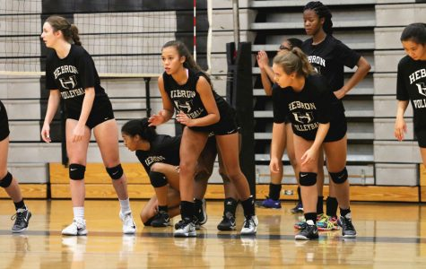 The volleyball team prepares to run sprints as they warm up for a tough practice. They play Marcus on Friday.