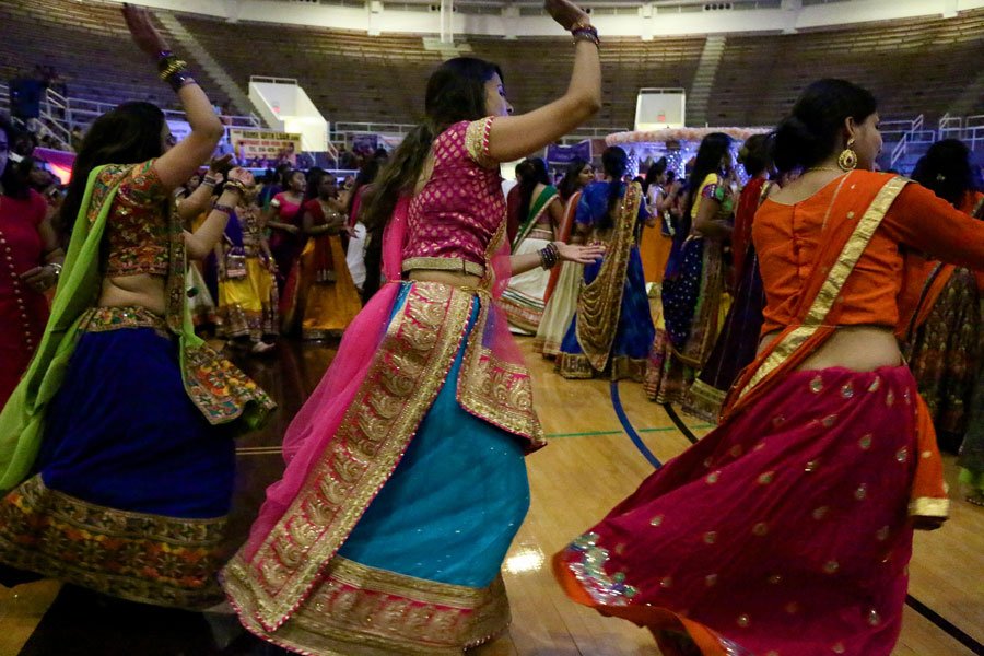 Three women start their own circle of dance as Garba starts.