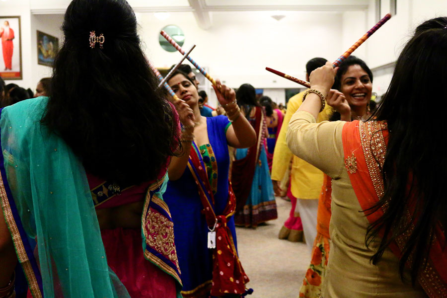 Women+form+two+lines+for+Dandiya%2C+a+dance+similar+to+Garba+except+with+colorful+sticks.