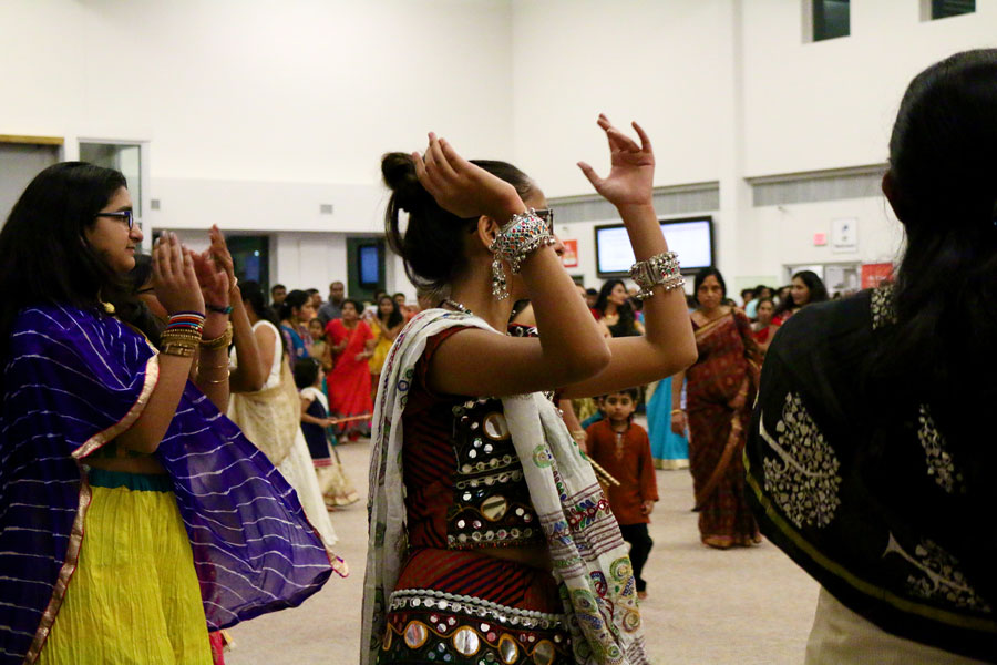 At the Hanuman Temple, people dance in a circle and clap as they follow the beat of the music.