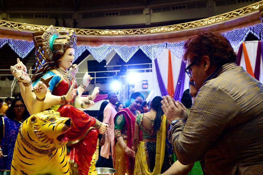 After aarti, a part of worship, is performed for Goddess Durga, people seek her blessings before Dandiya Raas begins.