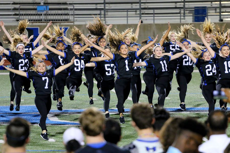 The Silver Wings perform their dance routine at the community pep rally held after the parade. They were preceded by the football moms dance routine.