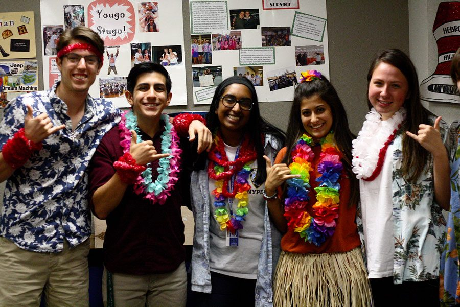 Stuco members Nathan Lewis, Kion Bordbar, Shalie Abraham, Melissa Ebrahimi, and Madison Green (left to right) pose for a picture in their Hawaiian attire. Stuco helped plan the red ribbon week spirit days.