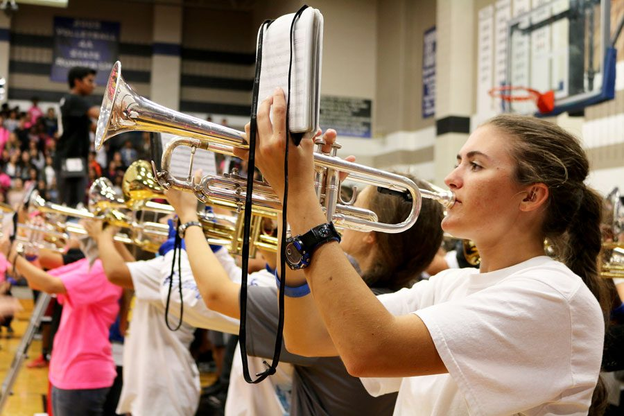 Senior+Rachel+plays+the+trumpet.+Band+played+as+the+students+filed+into+the+gym.