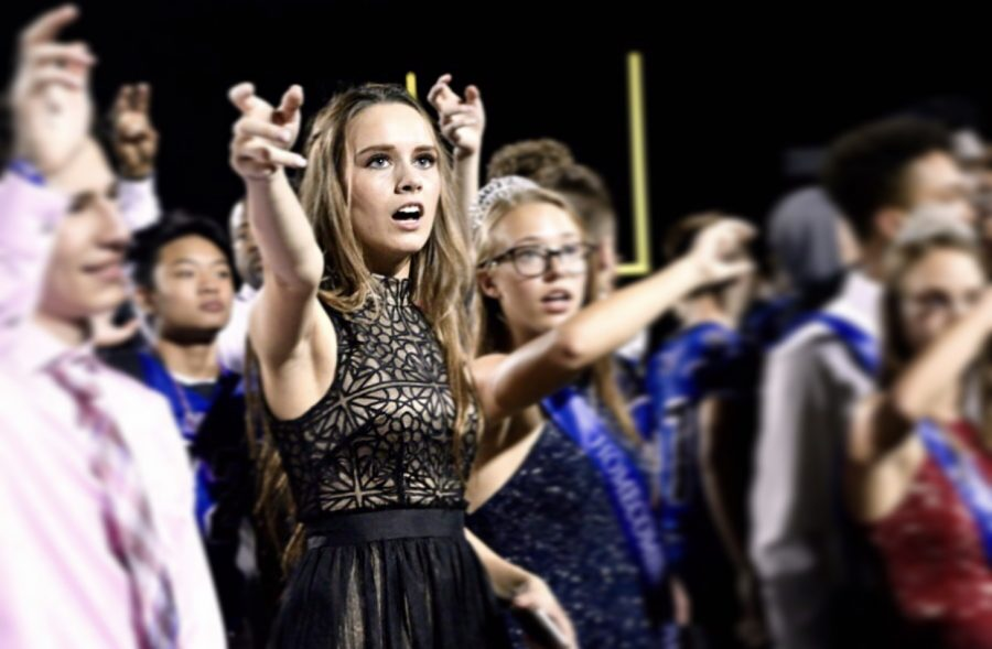Senior Skylar Boyd sings the alma mater with the rest of the students during the Homecoming game. Boyd was one of the Homecoming Queen nominees.