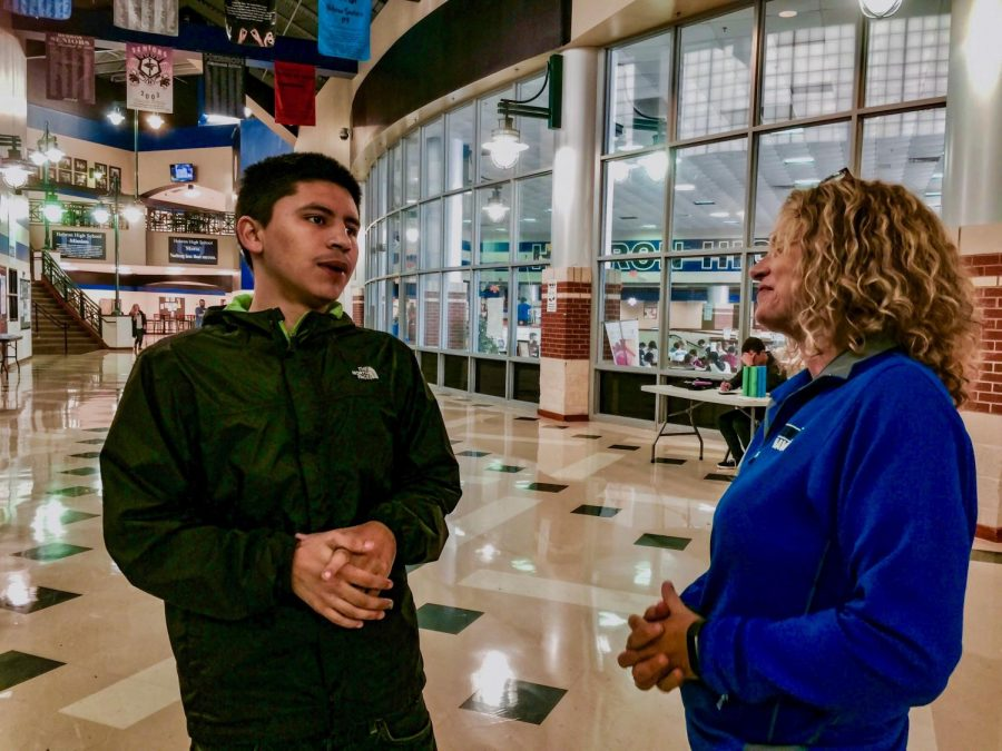 Daniel Elizardo discusses his plans for his future with assistant principal Sandra Lee. Elizardo said he wanted to open up a barber shop and pursue tattooing as a career.