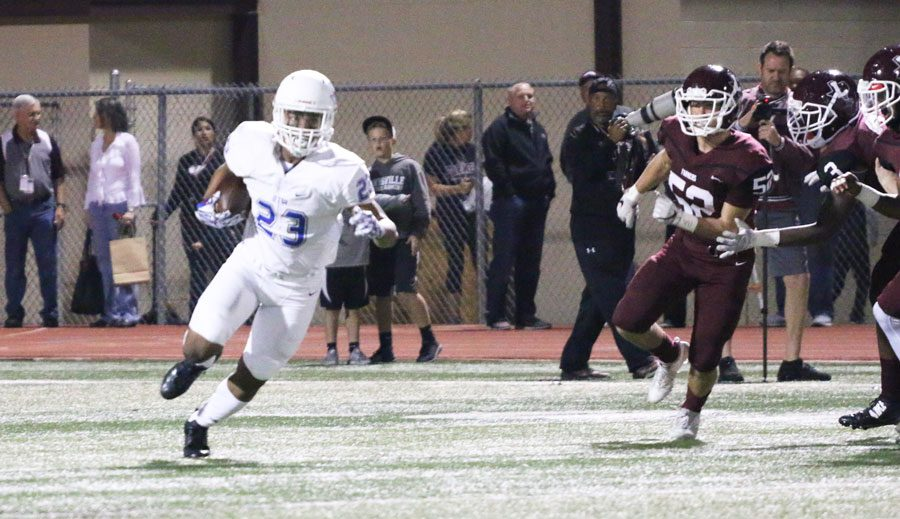 Sophomore free safety Darius Snow races ahead of the Lewisville players.