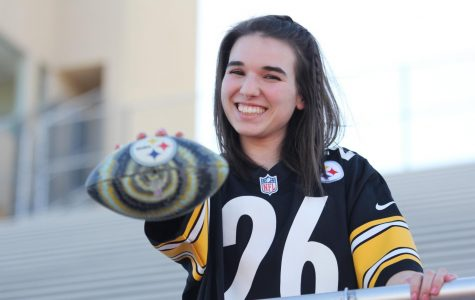Junior Isabel Diaz poses with a football.