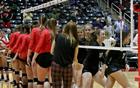 The Lady Hawks and Woodlands shake hands after the semifinals, in which the Lady Hawks won with a score of 3-0. The semifinals was held at the  Curtis Culwell Center in Garland on Nov. 17.