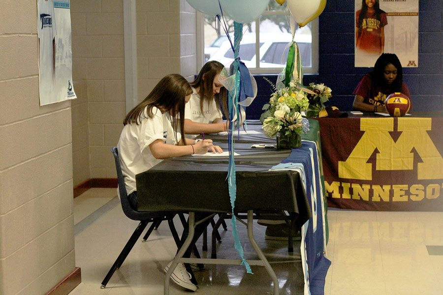 Seniors, Annie Benbow, Lauren Merrill, and Adanna Rollins signing their contracts to play for the colleges that they selected.  All three girls played on Varsity during the volleyball season.