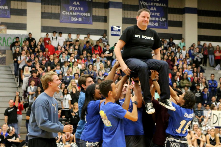 Student Council sponsor Benjamin Stroud is lifted off of the ground by senior Student Council officers. This was a part of Student Councils senior recognition skit.