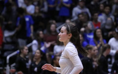 Senior Annie Benbow anticipates for the ball at the 2017 Volleyball Championships. Hebron was ranked first in state after winning the championships.