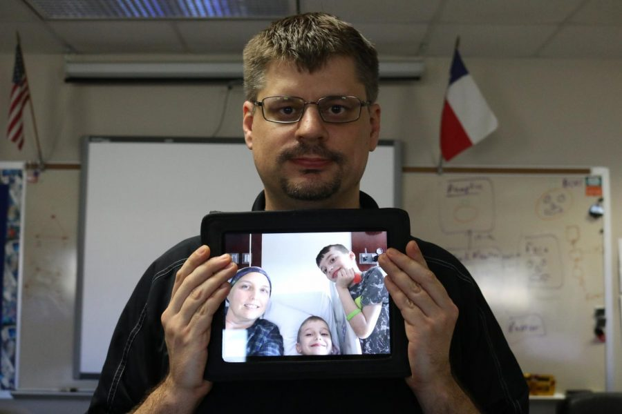 Mr. Stites poses with a picture of his wife and two sons. They were visiting her in the hospital.