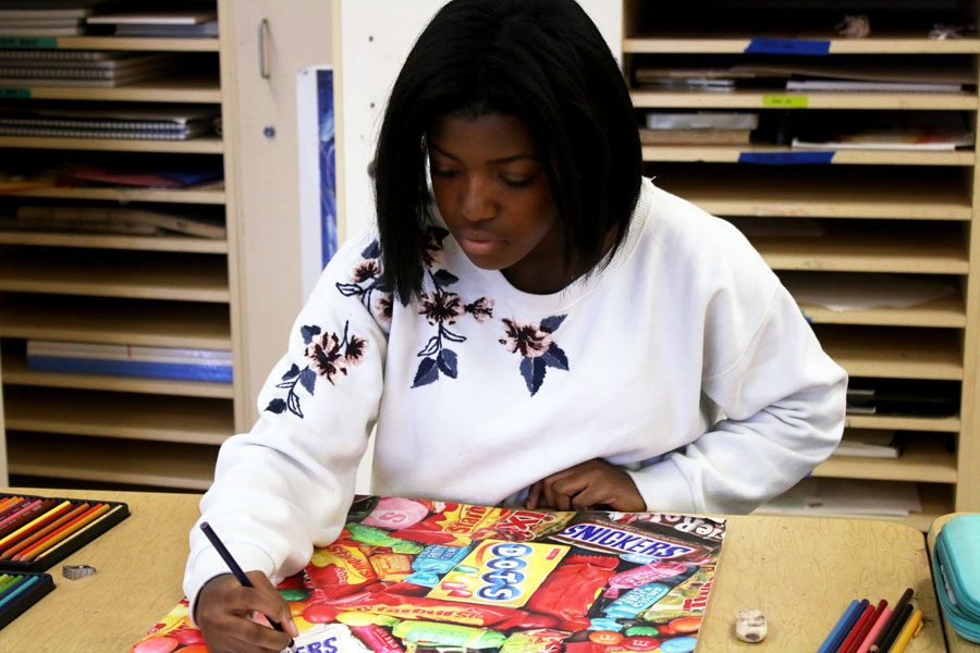 Senior Sade Oyedipe works on her piece