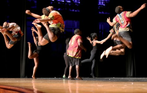 Showtime members jump in the air as part of their dance. The celebration addressed social issues such as racism.