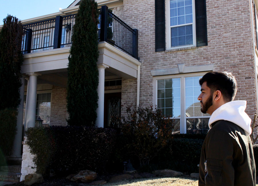 Rahil Baharia stands in front of the house where the burglary took place. Baharia moved six months after the event.