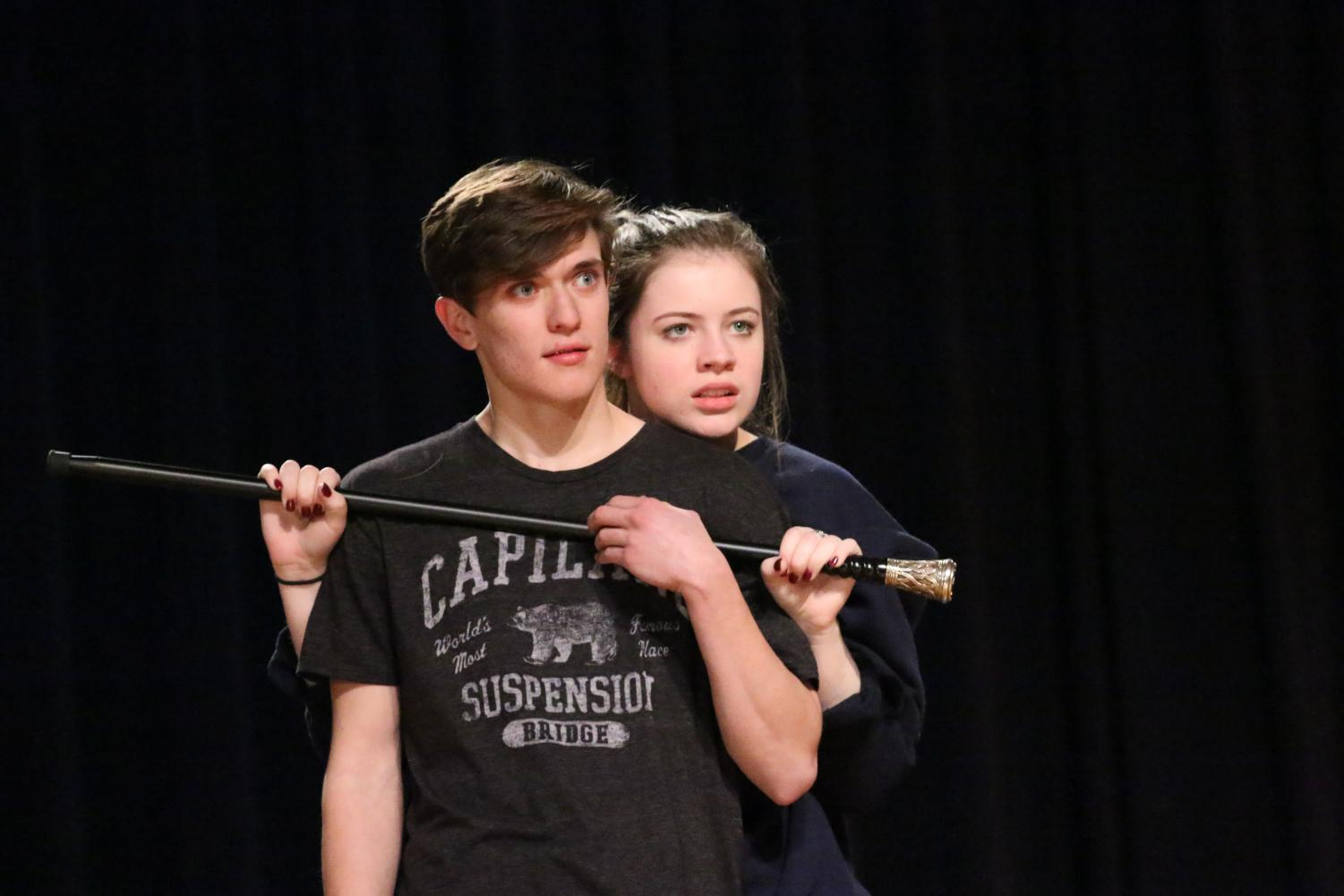 Senior Caleb Geddie, playing Antonio, and junior Caitlin Kresta, playing Meredith, rehearse the opening scene of Pinocchio.