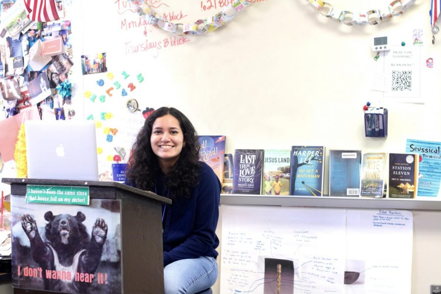 Senior Amna Yasin poses for a photo before teaching freshman and sophomores science before their competition in April. This year, Yasin is the co-captain of the Ac Dec team.