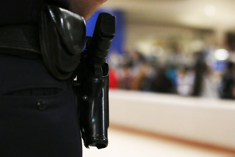 School resource officer Kevin Stiles stores his gun in his duty belt while at the school on Feb. 26.