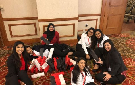 FCCLA members sit on the floor with their awards. They won 13 gold medals.