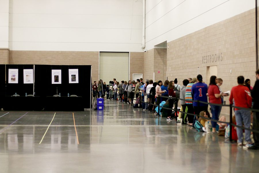 Fans wait in a line to get books signed. Signing started at 3:30 p.m.