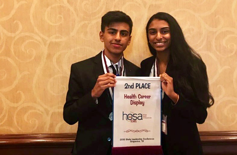 Juniors Jai Arora and Shraavya Chittoor pose with their award after winning 2nd place at State. They participated in Health Career Display.