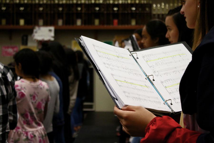 Sophomore Mia Nguyen sings