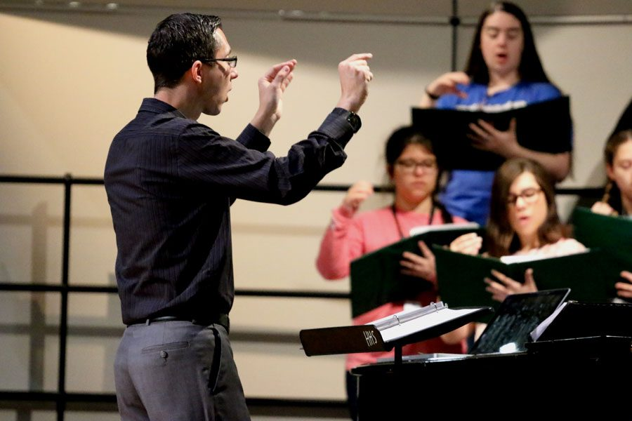 Choir director Nathan Ratliff practices with the choir as they learn their music. They will be attending the music festival that is held on Saturday.