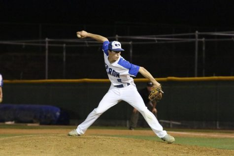 Before the season ended last year, senior Michael Betrus pitches for the Hawks.