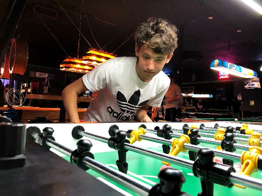 Sophomore Khoji Ybarra plays at a local foosball tournament. He has been playing foosball for around two years.