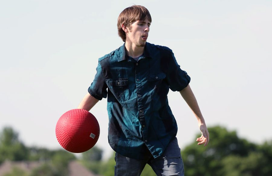 Sophomore Chad Akin pitches the ball in a game of kickball. The game was hosted on May 9 for journalism students to be able to capture pictures of sports action. I was very focused while pitching, Akin said. I play to win when it comes to kickball.