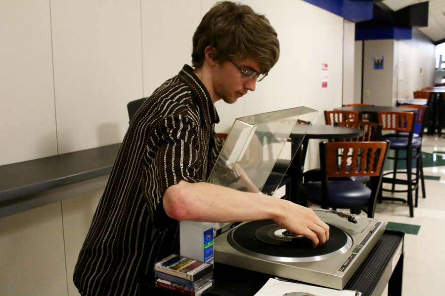 Senior Patrick Curran makes adjustments to a 1970s stero system.