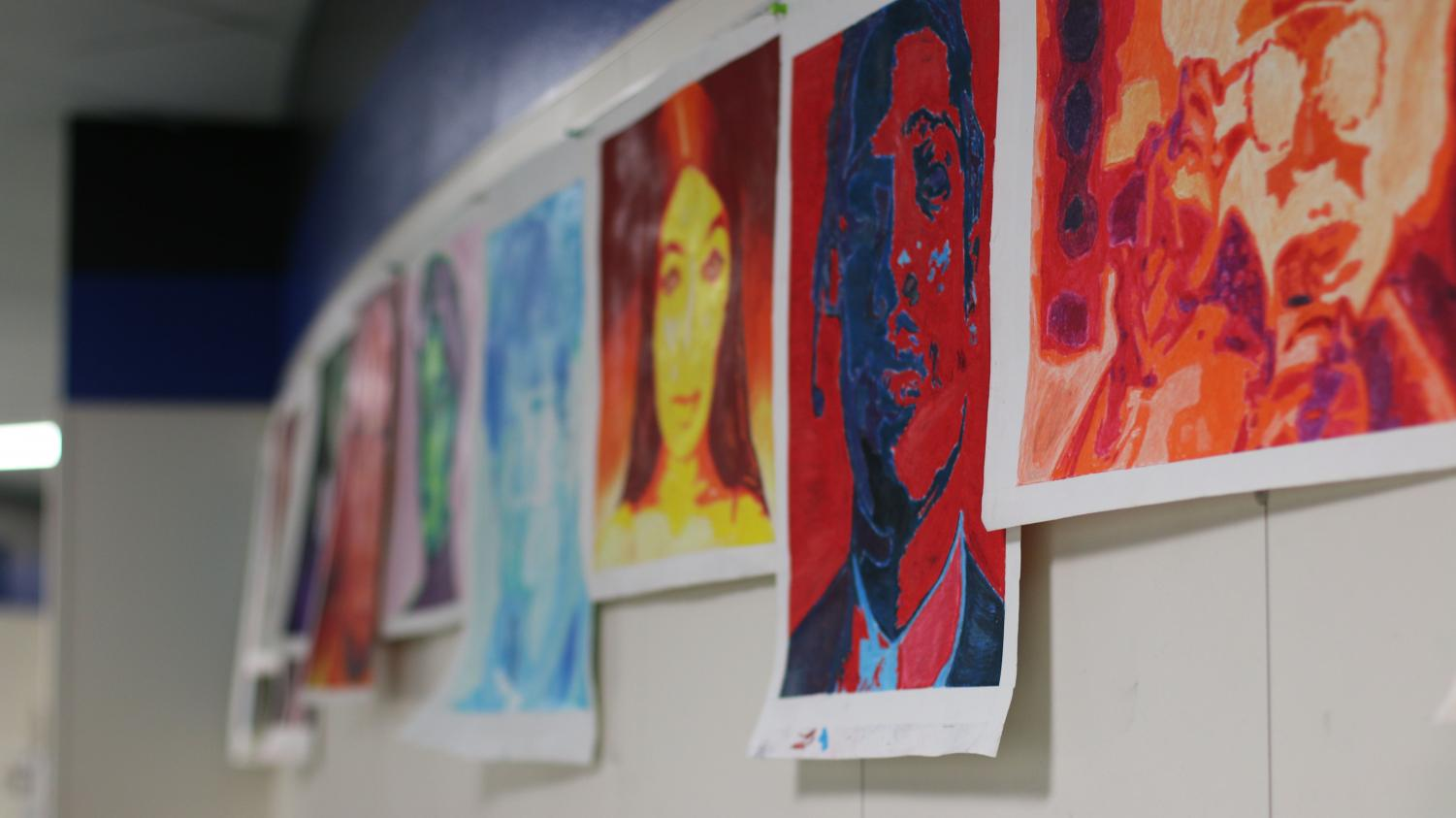 Art hangs on the walls. The art classes will present their pieces May 22.