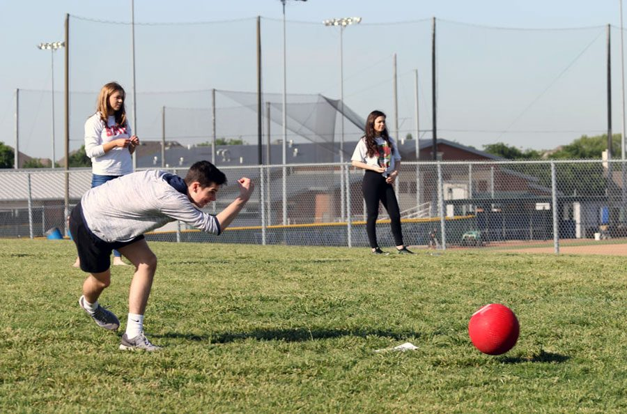 Sophomore Conner Schaefer pitches the ball during a game of kickball on May 9. Schaefer kicked the ball numerous times in addition to throwing pitches for his team.