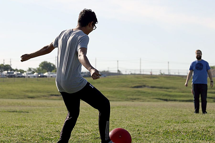 On May 9, junior Marco Orihuela gets ready to kick the ball as far as he can. His team had won the game of kickball.