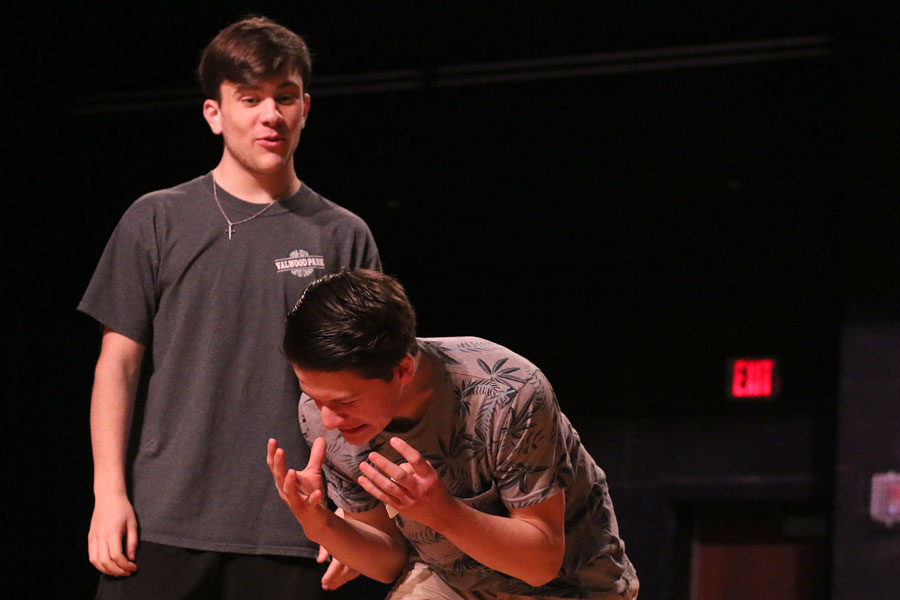 """Juniors Joseph Hoffman and Dalton Currey play the improv game """"confessions"""" during a practice before school on May 18. Theater's improv show will be held in the auditorium on May 24 at 7 p.m."""