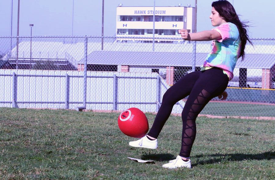 Sophomore Alexis Saldivar kicks the ball to try to score a point for her team. The kickball game was played at Hebron High school on May 9.