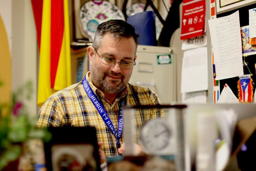 Spanish teacher Larry Horton sits down to grade his students' quizzes. Horton's students have had a 100 percent passing rate on the Spanish AP test for the past four years.