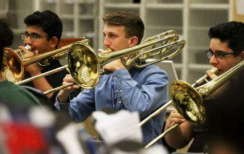 Sophomore Andrew Carroll looks at his music sheet as he plays his bass trombone. He received an Outstanding Soloist at the State Solo UIL.