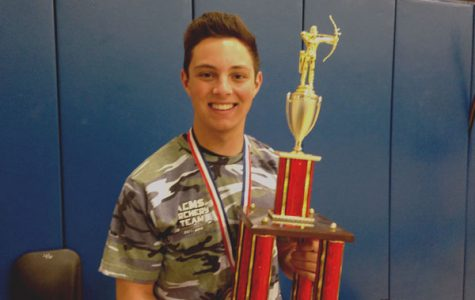 William Walters poses with his trophy. He won third place in last year's state tournament.