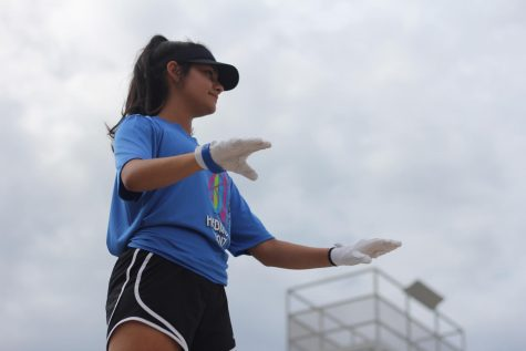 """Sophomore Michelle Arriaga conducts during an afternoon band rehearsal. She arrives early and stays late for every practice to help out and to be there people. """"I definitely have to dedicate a lot more time to the band program now,"""" Arriaga said."""