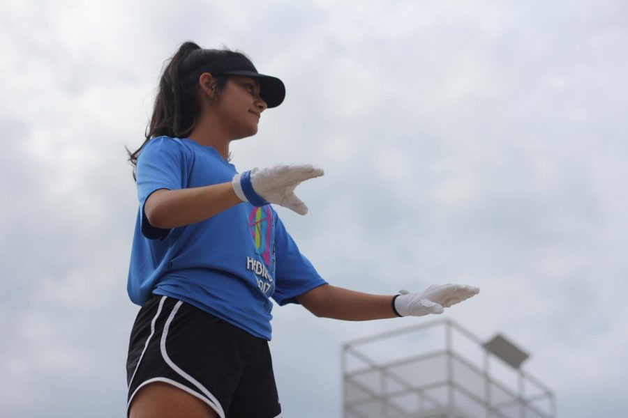 "Sophomore Michelle Arriaga conducts during an afternoon band rehearsal. She arrives early and stays late for every practice to help out and to be there people. ""I definitely have to dedicate a lot more time to the band program now,"" Arriaga said."