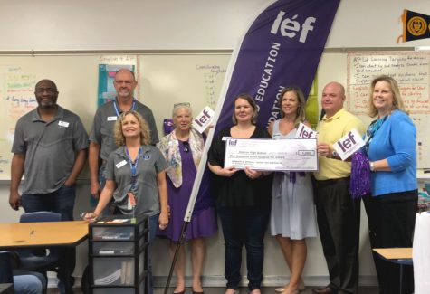 English 4 teacher Jeanny Haneline receives her LEF grant from the Hebron administration.