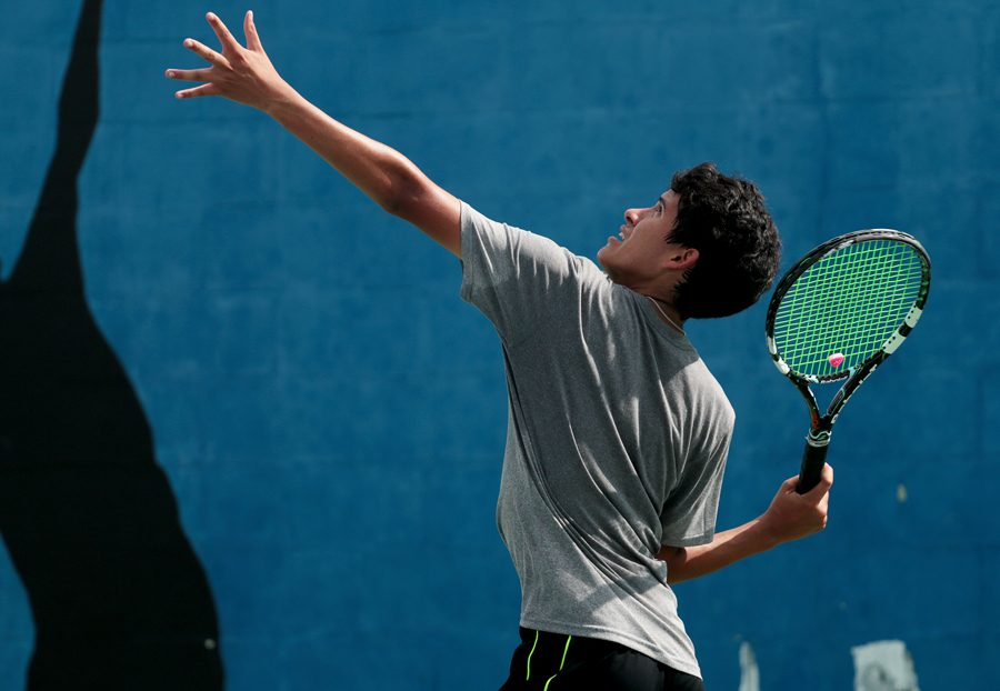 Senior+Connor+Willis+practices+after+school+with+senior+Amy+Nam+and+freshman+Micheal+Harris.+Tennis+lost+to+Marcus+6-13.+++
