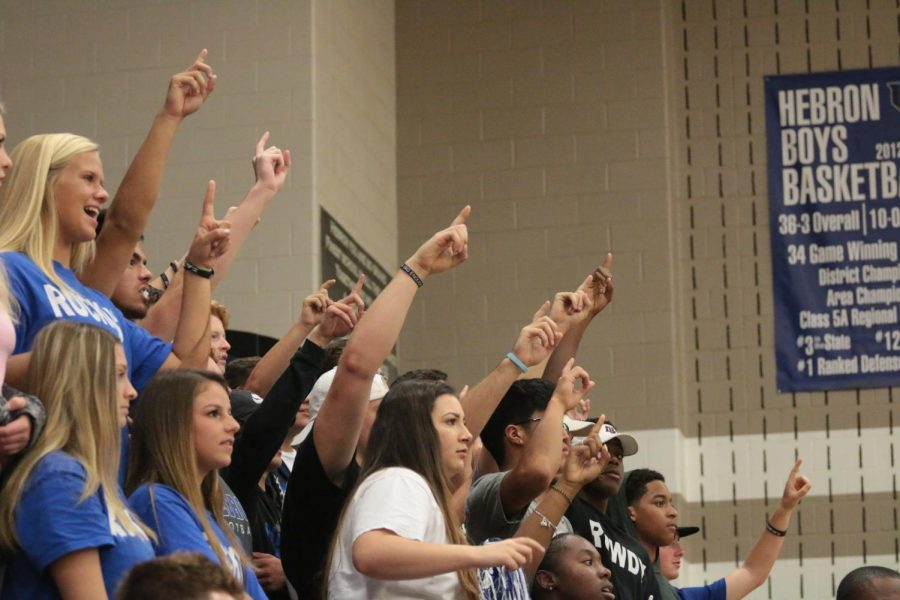 Ruckus and Rowdy members hold up one finger to rally having one point left in the game.