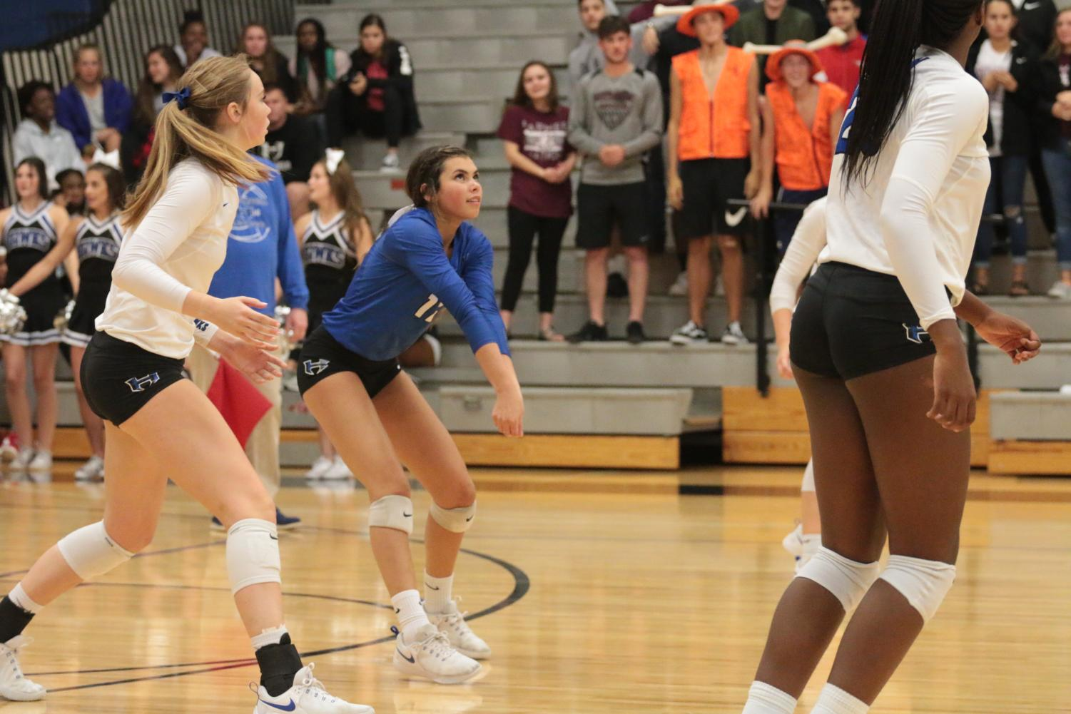 Junior Isabelle Ousby moves forward to save the ball in the game against Lewisville.