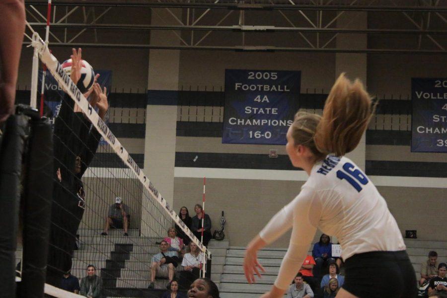 Senior Emma Clothier spikes the ball.