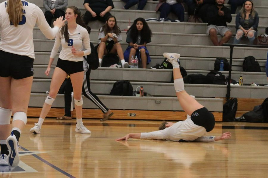 Sophomore Brooke Nichols falls after trying to save a ball.