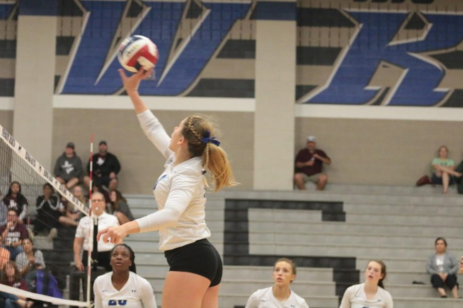 Sophomore Brooke Nichols tips the ball over the net.
