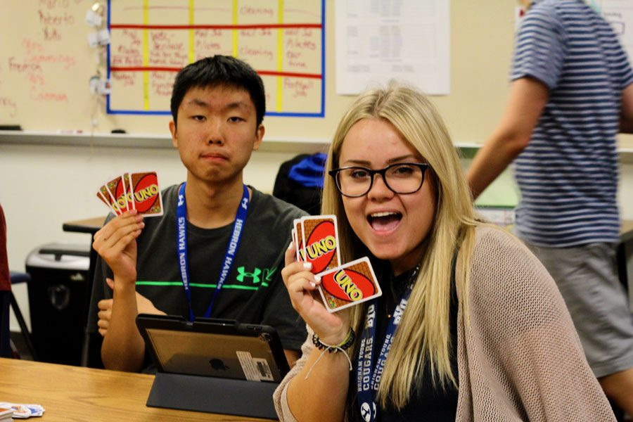 Senior Courtney Carroll poses while playing Uno with other Circle of Friends students.